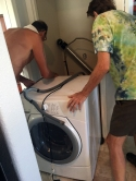 Doc and Jim remove the washer and dryer